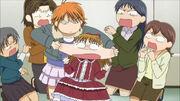 Kyoko pinches Maria's cheecks