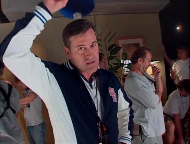 File:Coach Boomer with his hat off.png