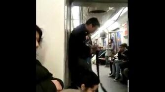 Crazy guy playing guitar in train