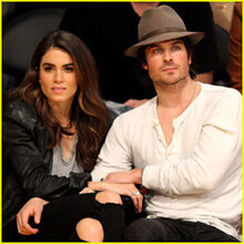 Ian-somerhalder-gives-nikki-reed-a-cute-kiss-at-lakers-game2