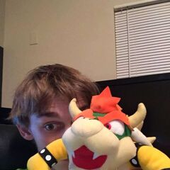 The picture Logan put on Facebook announcing his new Bowser plush.