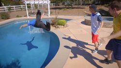 Guy Flawless tossing himself into the pool