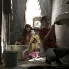 The Baudelaires cleaning the bathroom with a toothbrush.