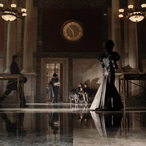 The Baudelaires waiting in the bank.