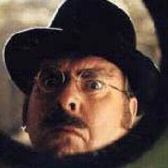 Mr. Poe looking through Olaf's peephole.