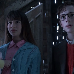 The Baudelaires looking at Olaf.