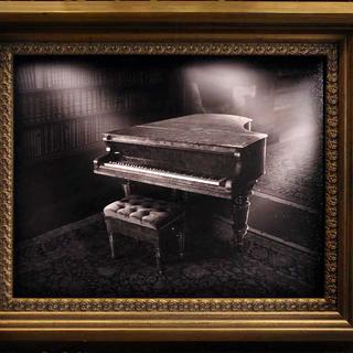 Bertrand hiding in a piano.