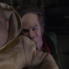 Count Olaf lifting Sunny.