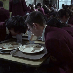 Students forced to eat with their hands tied behind their back.