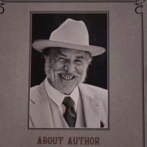 Sir on the cover of his book.