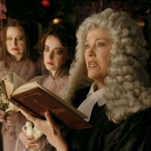 The judge marrying Olaf and Violet in the film. In the background, the <a href=
