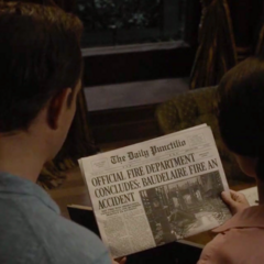 Reading the paper.