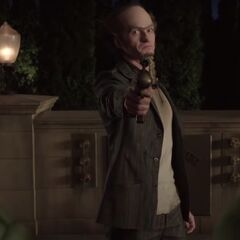 Olaf aiming a harpoon gun at Dewey and the Baudelaires.