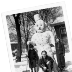 Three actors by the snowman.