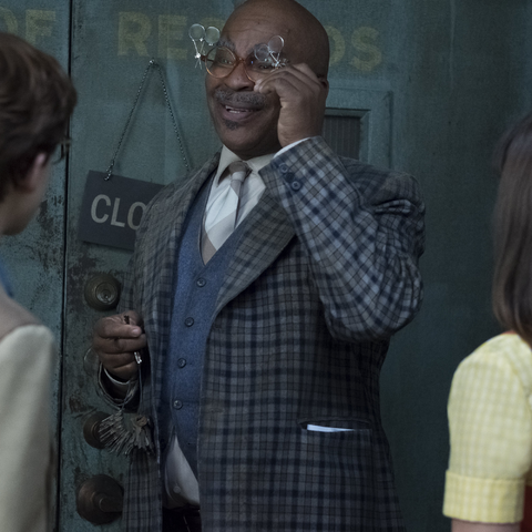 Hal showing the Baudelaires the Library of Records.