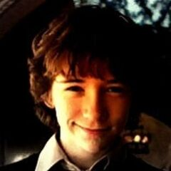 Klaus smiling.