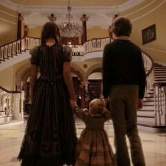 The Baudelaires in the mansion.