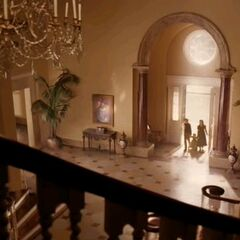The Baudelaires enter their pleasant mansion.