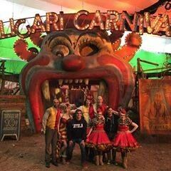 Cast posing at the entrance in front of the Caligari Carnival