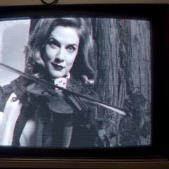 Dolores with a Violin.