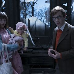 The Baudelaires in the ruins.