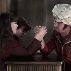 Violet and Klaus arm wrestling Coach Genghis.