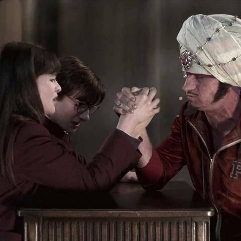 Violet and Klaus arm wrestling Coach Genghis.