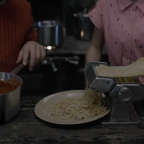 Violet making pasta in the TV series.