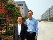 Eikichi Kawasaki with the chairman of Huali Technology (China 2011)