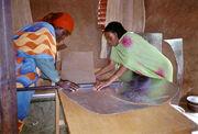 Iridimi folding solar cooker