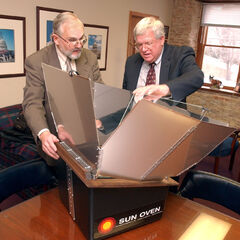 Explaining a Sun Oven to US House Speaker Dennis Hastert