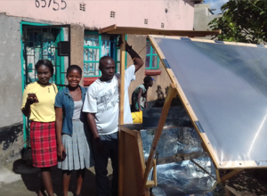 Clement Mosonda with the Heliac solar cooker, 5-8-18