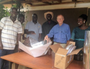 Roger Haines meets with the Alliance for African Assistance to discuss solar cooker distribution., photo - Roger Haines