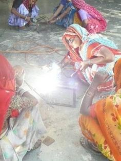 Barefoot College women students welding new Scheffler reflectors, 5-11