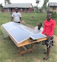 Esther Nattabi with solar dryer - July 2019