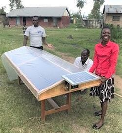 Esther Nattabi with solar dryer - July 2019