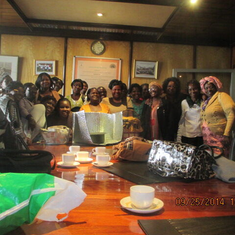 Mama Solar (Faustine Wama) poses with the Alliance women in coffee