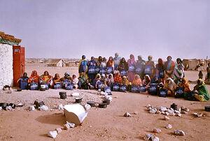 Iridimi refugee holding solar cookers