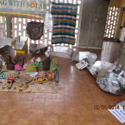 Solar cookers and plastic waste recycled items made by NAREWAMA on display at Tangaza college.