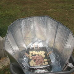 Wheelbarrow Windshield Cooker, voir aussi <a href=