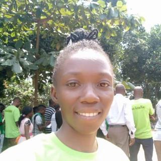 Ester Nattabi presents solar and fireless cooking concepts at Green Day in Kampala, Uganda.