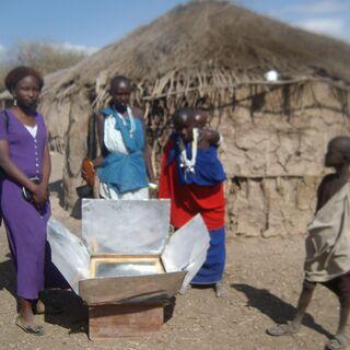 Nangai is holding milk ready for cooking outside her house. <i>Photo credit: Sperancea Gabone</i>