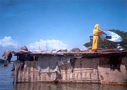 Bangladeshi woman cooking in flood