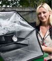 Kate Rowland with Sunflair solar oven.jpg