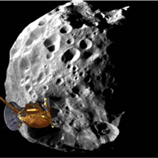 Cassini making a flyby past Phoebe, one of Saturn's smaller moons.