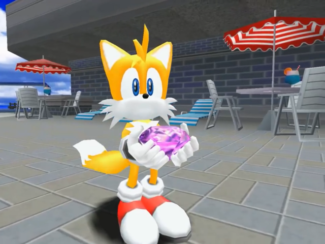 File:Tails showing his Chaos Emerald.png
