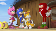 Team Sonic looking at Knuckles
