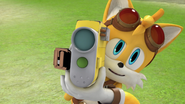 Tails holding the camera