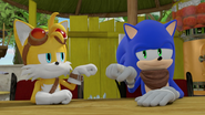 Sonic and Tails fist bump