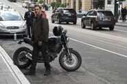 Eddie Brock by his motorbike promotional still